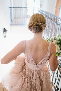 Bride's gown and hair in detail in Ojai Valley Inn wedding. Photo by Marianne Wilson Photography (via Style Me Pretty).