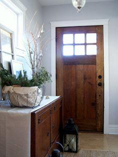 love this front door... dark wood, windows in door, white trim