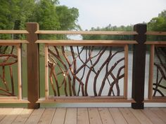 The rustic twig design of the railing is a nice touch around this deck with a river view in North Carolina. Description from houzz.com. I searched for this on bing.com/images