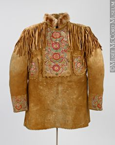 Shirt -Western Subarctic  Aboriginal: Dene or Western Cree  1890-1910, 19th century or 20th century  Tanned and smoked moosehide, silk embroidery floss, cotton cloth, metal buttons, beaver? fur, cotton thread, metal (hooks). Shown at McCord Museum