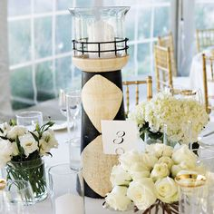 A lighthouse surrounded by flowers fits beautifully in a seaside reception
