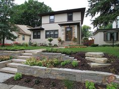 how to landscape front yard slope | Front Yard Natural Stone Terracing Walls by Ground One of Mn