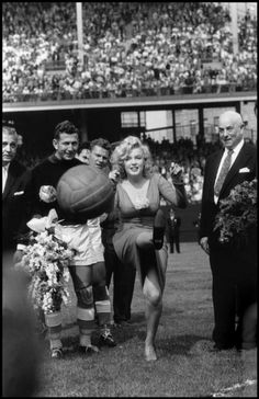 Marilyn Monroe kicks off a football match in New York, 1959. Photograph by Bob Henriques, courtesy of Magnum Photos.