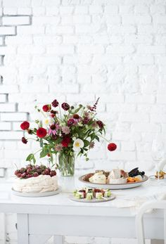 Not only is the white brick in the background fantastic, but we're crushing on the flower arrangement on the table. It looks fantastic against the colorless backdrop.