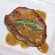 """Creamy Pork Chops 6 pork chops salt, pepper, garlic powder to taste 1/2 C flour 1 lg onion, sliced 1/4"""" thick 2 cubes chicken bouillon 2 C boiling water 2 T flour 1 (8 oz) sour cream Season chops w/salt, pepper, garlic powder, then press into 1/2 C flour. In skillet over med heat, lightly brown in small amount of oil. Place in crock-pot,top w/onion slices. Dissolve bouillon cubes in boiling water/pour over chops. Cover, cook on Low 7-8 hrs."""