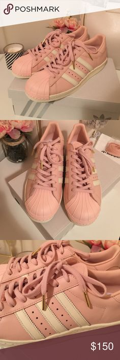 Pink adidas superstar These are custom made adidas superstar. It took a month to make but I payed for express shipping. It's a size 7.5 but it runs kinda big so more of an 8. It was too big for me so I have to let it go. Has a gold tip on shoe lace. Comes with dust bag and extra shoe laces. No bundling this item. $100 with free shipping if you meet me on ♏️ Adidas Shoes Athletic Shoes