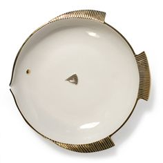 J.A. Here fishy, fishy!   White porcelain with a high gloss glaze and real gold detailing creates an understated look of luxe.