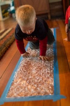 a Bubble Wrap Runway for Kids of All Ages Next time I get bubble wrap -- tape it down to the floor for a fun runway!Next time I get bubble wrap -- tape it down to the floor for a fun runway! Activities For 2 Year Olds, Gross Motor Activities, Indoor Activities, Infant Activities, Preschool Activities, Children Activities, Baby Sensory Play, Baby Play, Sensory Art