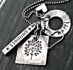 Family Tree Sterling Silver Charm Necklace...I have 2 boys and I think this has a masculine look.