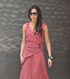 Victoria Beckham in a red dress and sunglasses