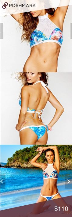 Beach Bunny Wavelengths Bikini Gorgeous bikini from Beach Bunny. The top is beautiful with mesh whit cut-out surrounding the lush blue with floral design. The bottoms also feature a white mesh cut-out on each side, and are skimpy coverage. Beach Bunny Swim Bikinis