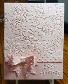 handmade card: Best Friends by jandjccc ... monochromatic pastel pink ... embossing folder texture of flowers (looks like one of Anna Griffin's gorgeous designs) on background ... Swiss Dots embossing folder texture for paper bow ... sentiment dry embossed  too ... luv it!