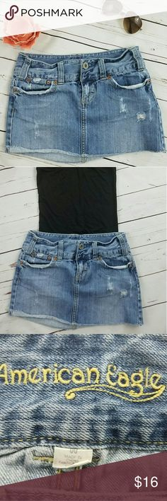 "American Eagle Denim Mini Distressed Skirt-Size 00 Super cute denim distressed mini skirt perfect for summer weather. Gently Pre-loved. Very good condition no holes, tears, rips, or stains. Very well made. No fading. Measurements: Waist- 14"" Length- 13"" No Trades - Smoke free home. Bundles are accepted for big discount leave a comment below. Make us an offer.   Fast Shipping- Will ship same day or next day depending on time item was purchased.   Thank you for visiting our closet hope to see…"