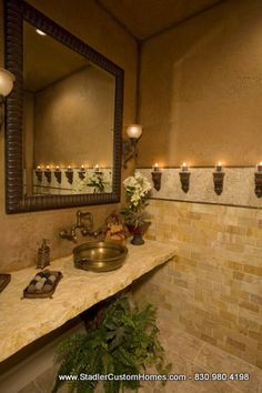 Hate the colors and stone but love the idea of putting the countertop like that with the faucet coming out of the wall.