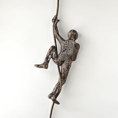 Contemporary metal wall art - Climbing man sculpture on rope - wire mesh sculpture - wall hanging.  This unique sculpture of a man climbing on rope is