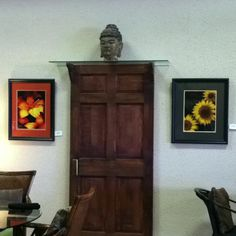 Interesting use of old door! Brackets added to create a glass shelf for the Buddha head!