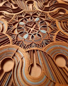 Cut Plywood Relief Sculptures Embedded with Mandalas and Geometric Patterns by Gabriel Schama | Colossal