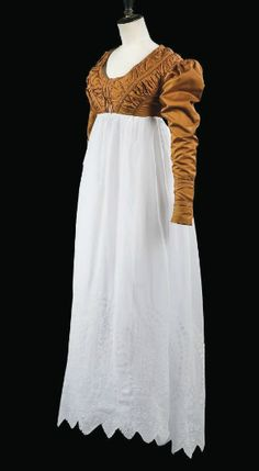 A spencer jacket of chestnut brown silk and associated skirt, c. 1815.