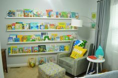 Adorable book-themed nursery! So bright and colorful and fun