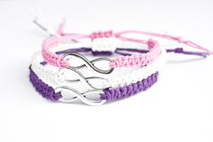 This listing is for 3 infinity friendship bracelets. Perfect for three best friends! These are made of purple, pink and white hemp. At the center of the bracelets are an antique silver infinity charm.