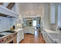 Love the ceiling in this kitchen!  #whitekitchen --- always a sucker for a white kitchen
