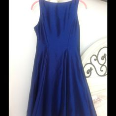 Royal blue formal dress. Knee length. Fit n flare Classy in pristine condition. Ready to ship. I also have a little under shirt that was custom made to cover more on the top, I can include that for free. Also check out my closet for other vintage, unique and modest dresses , purses, skirts and more! Dresses