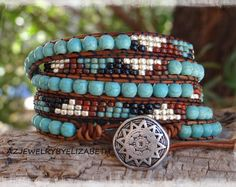 TURQUOISE LEATHER WRAP BRACELET/ TRIPLE WRAP BRACELET SOUTHWESTERN STYLE WITH TURQUOISE AND SEED BEADS/ NATIVE AMERICAN LEATHER WRAP BRACELET. THIS LEATHER BRACELET IS MADE TO WRAP AROUND YOUR WRIST 3 TIMES  YOU HAVE YOUR CHOICE OF MANY BUTTONS. IF THERES AN ITEM WITH A PARTICULAR BUTTON YOUD LIKE ON ANOTHER BRACELET, PLEASE LET ME KNOW.  PLEASE MEASURE YOUR WRIST SIZE BEFORE YOU ORDER THANK YOU FOR STOPPING BY, PLEASE CONTACT ME IF YOU HAVE ANY QUESTIONS.  PLEASE READ MY SHOP POLICIES…