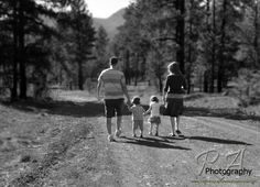 Black and White Family Photo. I always love the family walking down the road together.
