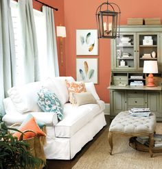 The feather prints inspired this living room, with aquas and shades of coral.