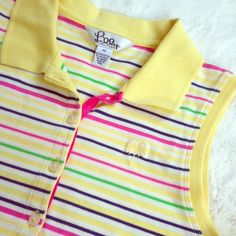 LILLY PULITZER Sleeveless Striped Polo This lovely sleeveless resort wear polo in sunshine yellow and multicolored stripe from Lilly Pulitzer is a must have for your casual summer wardrobe! Palm tree logo on top left. 95% Pima cotton, 5% spandex. Gently preloved and in excellent condition. All buttons intact. No stains or signs of wear.  Lilly Pulitzer Tops