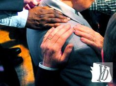 A laying on of hands shows support for York's elected leaders during a National Day of Prayer event in York.