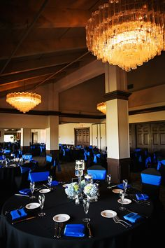 Traditional Wedding Reception Décor with Black Tablecloths, Royal Blue Chair Covers and Napkins with Blue and Ivory Hydrangea Centerpieces at Countryside Country Club Wedding Venue | Limelight Photography