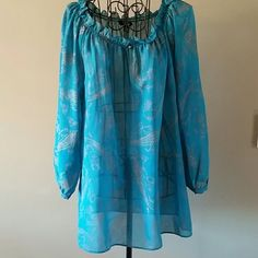Sheer top size large I bought this at Macy's and wore it one time. That's how I tend to do things.   Size large and true to size.   100% polyester so no ironing.   Great color.   Make me an offer or bundle to save even more. The more you buy the more you save. Just ask :). Chaps Tops Blouses