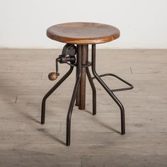 Pulling up a stool to your breakfast bar will be easy with this adjustable bar stool. With just a turn of the crank, you can adjust the stool to the perfect height to suit your needs. The stool has an industrial look that will pair well with any decor.