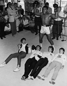 Mohammed Ali knocks out the boys.. Paul, John, George, and Ringo