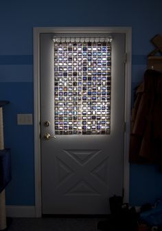 "#DIY ""Curtain"" made of old film slides - Drill 8 holes in each slide and connect with metal rings - Creates a sort of ""stained glass"" effect while reusing something in a new way."