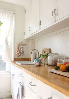 white kitchen light wood counter top.