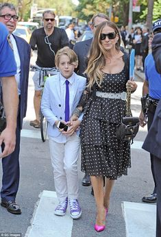 Other man: The actress and designer can be seen with her 12-year-old sonJames Wilkie at J...