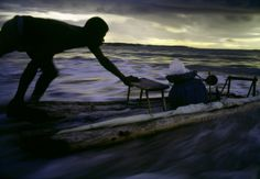 Miguel Rio Branco - Salvador de Bahia. Piata Beach. A Jangadeiro goes fishing. 1984.