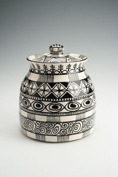 """This cookie jar has tons of ornate hand painted designs. Makes a major statement at 7-1/2"""" diameter by 9"""" tall. Beautiful black and white. Looks"""