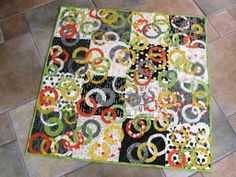 Making interlocking rings on a quilt pattern can seem very difficult, but not if you're using the Ring Around the Baby Quilt as your guide. Not only will you have a unique and playful baby quilt design, but a new way to approach your quilt designing.