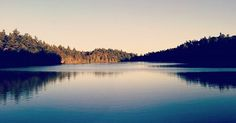 Panoramic view of Pink Lake, Gatineau Park. Photo by Marwan Kishek  #pinklake #gatineau #quebec #canada #canoeing #summer #lakescape #panorama #canon📷 #canon #imagesofcanada #sunsets #pink #lake #blue #waters #ottawa