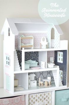 Dollhouse renovation by The Reinvented Housewife! Doll house remodel, dollhouse renovation, DIY dollhouse, pink, gold, navy, aqua, modern, girly, wallpaper, kid-proof dollhouse flooring, dollhouse tutorial, Calico Critters dollhouse.