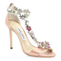 "reign crystal-embellished satin t-strap sandals by Jimmy Choo. Multicolor crystal strap elevates luxe satin sandal. Self-covered heel, 4"" (100mm).Satin and crystal upper. Open toe. Lobster clasp. Leather lining and sole. Made in Italy. #jimmychoo #nudeshoes #sandals"