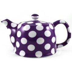 purple tea pot with white polka dots