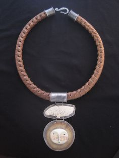 Kuna Moon Child All those nights with the Kunas and the moon- sweet memories. Sterling Silver Snake Vertebrae Carved and Pigmented Bone Found Whalebone Bamboo.  PRICE $ 895
