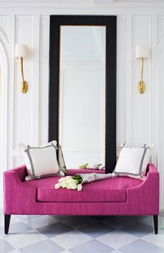 Showstopper Entry ~ Fuchsia bench with tall mirror & gold sconces against full paneled walls