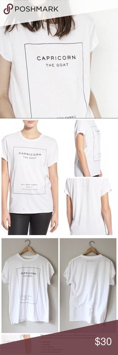 'Capricorn' Crew Neck Tee Super soft one size fits all tee in white with black lettering. In excellent gently used condition. The Laundry Room Tops Tees - Short Sleeve