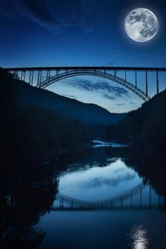 New River Gorge Bridge in West Virginia at night by the light of a full moon, photo by Beth Forester. West Virginia, New River Gorge, Espanto, Moon Photos, Moon Pictures, Shoot The Moon, Beautiful Moon, Scenery, Places To Visit