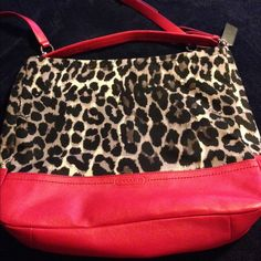 Coach black and red purse Coach purse. Satchel style or handle. Red black and white print. Never used. Matching wallet but the wallet has been used. Great purse! Coach Bags Shoulder Bags